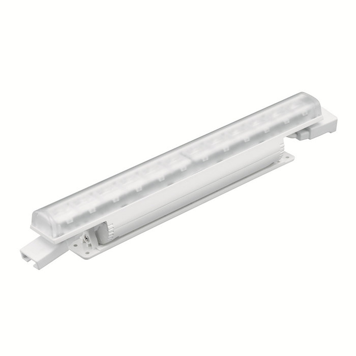Linear interior LED wall grazing fixture with solid color light