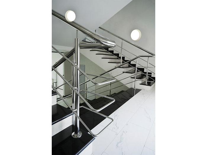 CoreLine wall-mounted luminaire in use in a black and white staircase