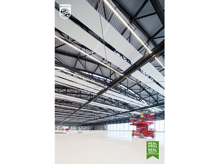 Spacious stockroom with a forkliftruck in a warehouse