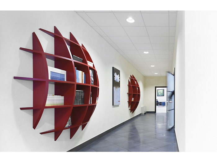 CoreLine downlight in use in a corridor with red bookshelves