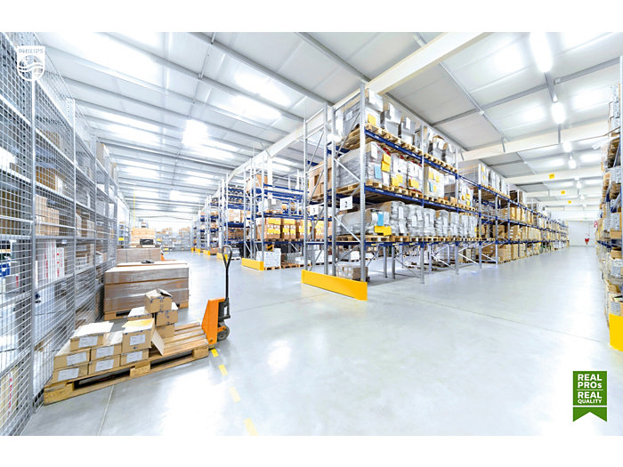 Forkliftruck in awarehouse stockroom with pallets